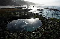 Shellfish harvestersat Dawn, Arniston, Western Cape, South Africa,