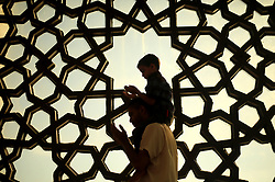June 10, 2017 - Gaza City, The Gaza Strip, Palestine - A Palestinian father and his sons pray in Al-Khalde mosque during the Muslim holy month of Ramadan in Gaza City, the Gaza Strip, 10 June 2017 . Muslims around the world celebrate the holy month of Ramadan by praying during the night time and abstaining from eating, drinking, and sexual acts daily between sunrise and sunset. Ramadan is the ninth month in the Islamic calendar and it is believed that the Koran‰??s first verse was revealed during its last 10 nights. (Credit Image: © Mahmoud Issa/Quds Net News via ZUMA Wire)