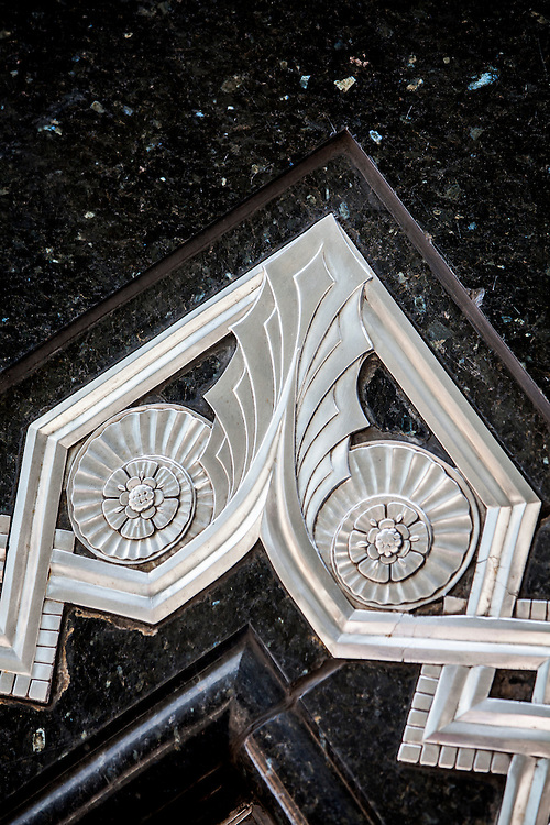 Detail of a metal bas relief inlaid into the black marble, ground floor facade of the Chrysler Building