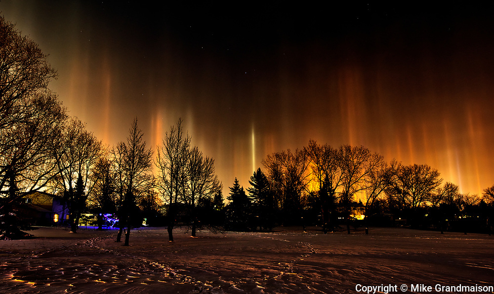Light pillars originating from artificial light sources. Southdale Neighbourhood. <br />Winnipeg<br />Manitoba<br />Canada