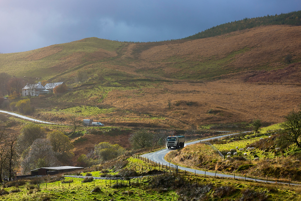 Truck driving through the Brecon Beacons for logging timber production in Wales, UK