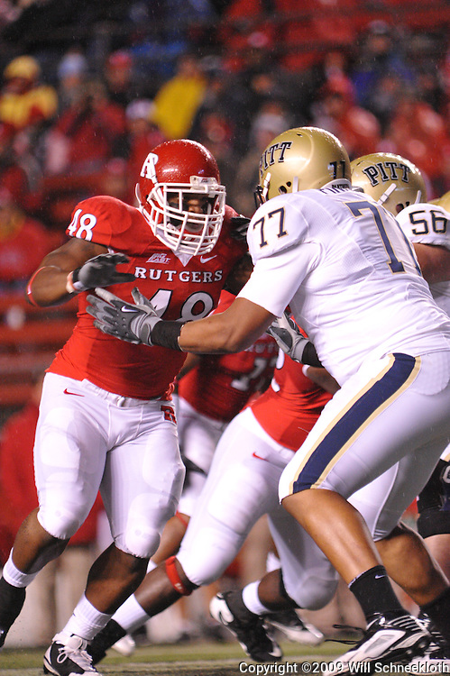 Oct 16, 2009; Piscataway, NJ, USA; Rutgers defensive tackle Blair Bines (48) battles Pittsburgh offensive lineman Jason Pinkston (77) during first half NCAA football action in Pittsburgh's 24-17 victory over Rutgers at Rutgers Stadium.