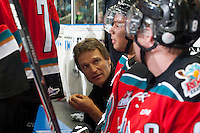 KELOWNA, CANADA - OCTOBER 11: Scott Hoyer, athletic therapist for the Kelowna Rockets checks in with players on the bench against the Lethbridge Hurricanes on October 11, 2014 at Prospera Place in Kelowna, British Columbia, Canada.   (Photo by Marissa Baecker/Shoot the Breeze)  *** Local Caption *** Scott Hoyer;
