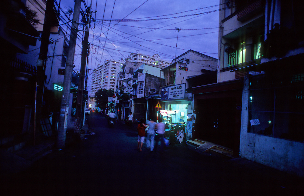 Local Vietnamese girls go for a walk in the evening cool. Evening in Ho Chi Minh City Vietnam