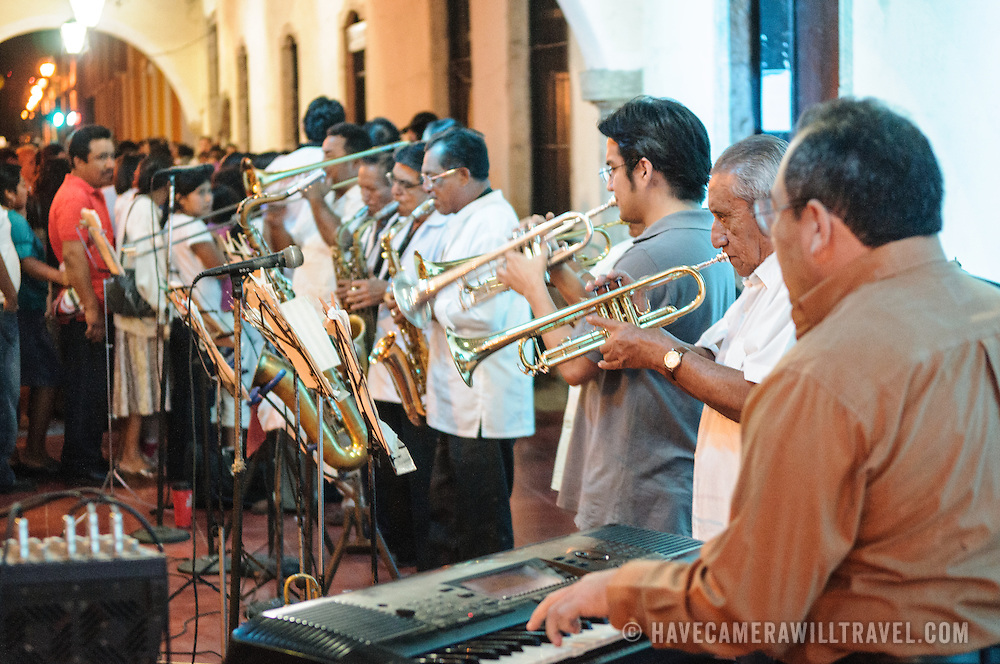A band entertains the crowd as part of the celebrations next to main square for the Queen of the Maya 2011 Festival in downtown Valladolid, a colonial town in the heart of Mexico's Yucatan Peninsula.
