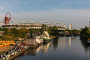 The River Lea and Queen Elizabeth Olympic Park which houses hip restaurants and startups during the coronavirus pandemic on the 7th May 2020 in London, United Kingdom. The Olympic sports venues nearby include the London Stadium, now home to West Ham United soccer team, and Lee Valley Velopark.
