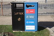 Litter bins for sorted rubbish recycling in a street, UK