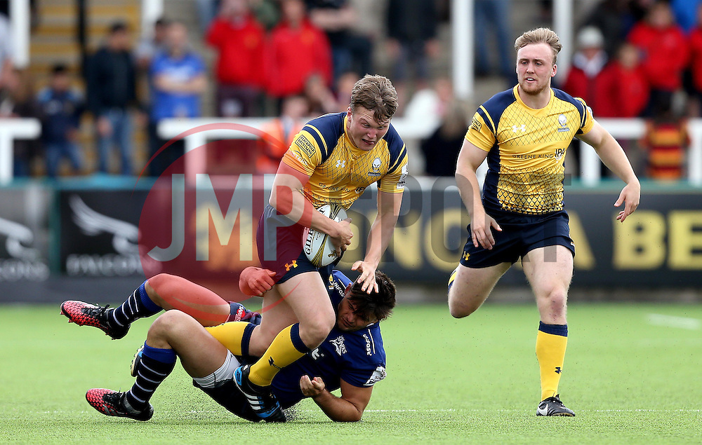 Ted Hill of Worcester Warriors runs over the tackle of Matt Rogerson of Sale Sharks - Mandatory by-line: Robbie Stephenson/JMP - 30/07/2016 - RUGBY - Kingston Park - Newcastle, England - Worcester Warriors v Sale Sharks - Singha Premiership 7s
