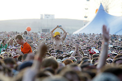 Fans of the band REM, headline the main stage on Saturday, T in the Park 2003..Pic: © Michael Schofield.