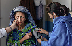 Afghan women visit the non-governmental organization Marie Stopes which gives medical help to women and their children August 6, 2002 in Kabul, Afghanistan.    (photo by Ami Vitale)