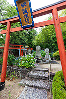 """Shinto Shrine at Goshoji Temple - Midway up a small hill facing the Seto Inland Sea is Goshoji Temple, the 78th sacred spot along the Shikoku Henro pilgrimage. It is said that Kobo Daishi paid a visit to Goshoji Temple in 807, where he made a vow to ward off evil, and built a statue there. Even today Goshoji is famous as the temple """"where Kobo Daishi wards off evil"""". During the Kamakura period, Ippen Shonin, the founder of the Jishu sect, visited Goshoji Temple and propagated the Nenbutsu Odori, a type of Buddhist incantation with dance. As a result, Goshoji Temple is the only temple belonging to the Jishu sect on the Shikoku Henro pilgrimage. As the majority of sacred spots on the pilgrimage are associated with the Shingon sect of Buddhism, the fact that Goshoji Temple is a place of worship for both the Shingon sect and the Jishu sect makes it very unique."""