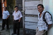 """Luciano Sho (right), 52, cacao grower from San Antonio, stands outside the TCGA's office. Mr. Sho switched from rice farming in 2004 and joined the TCGA in 2005. He now has 17,000 cacao trees and is one of the organization's most successful members. """"Thanks to the TCGA and Fair Trade for providing us great benefits. I have 13 children and many have been granted Fair Trade scholarships. I am very proud to belong to the TCGA."""" Toledo Cacao Growers' Association (TCGA), Punta Gorda, Toledo, Belize. January 28, 2013."""