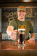 Bartender Michael McMillen pours me a pint.