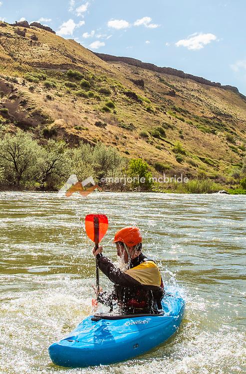 Kayaker rolls while kayaking the Hagerman in Idaho.