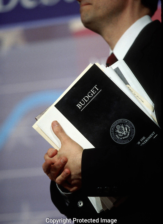 A 26.3 MG FILE FROM FILM OF:.The U.S budget clutched in the hands of a Presidential aid. Photo by Dennis Brack