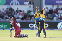 July 1, 2019 - Chester Le Street, County Durham, United Kingdom - Jeffrey Vandersay of Sri Lanka celebrates with Jeevan Mendis after their combined to dismiss West Indies' Jason Holder                         during the ICC Cricket World Cup 2019 match between Sri Lanka and West Indies at Emirates Riverside, Chester le Street on Monday 1st July 2019. (Credit Image: © Mi News/NurPhoto via ZUMA Press)