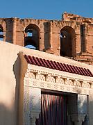 Doorway decorated with Islamic tilework in from of Roman amphitheatre, El Djem, Tunisia