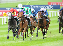 Mr Lupton ridden by Jamie Spencer (green centre) goes on to win The Weatherbys Ireland Greenland Stakes during day one of the Curragh Spring Festival at Curragh Racecourse, County Kildare