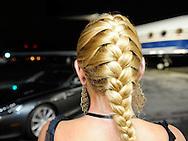 Lady with braid Curator