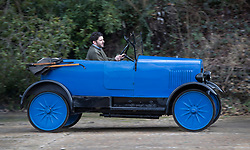 © Licensed to London News Pictures. 28/01/2018. Weybridge, UK. Competitor Frazer Sloan drives a 1925 Trojan Utility at Brooklands Museum as he takes part in The Vintage Sports-Car Club's New Year driving tests round the historic motor racing circuit. Photo credit: Peter Macdiarmid/LNP