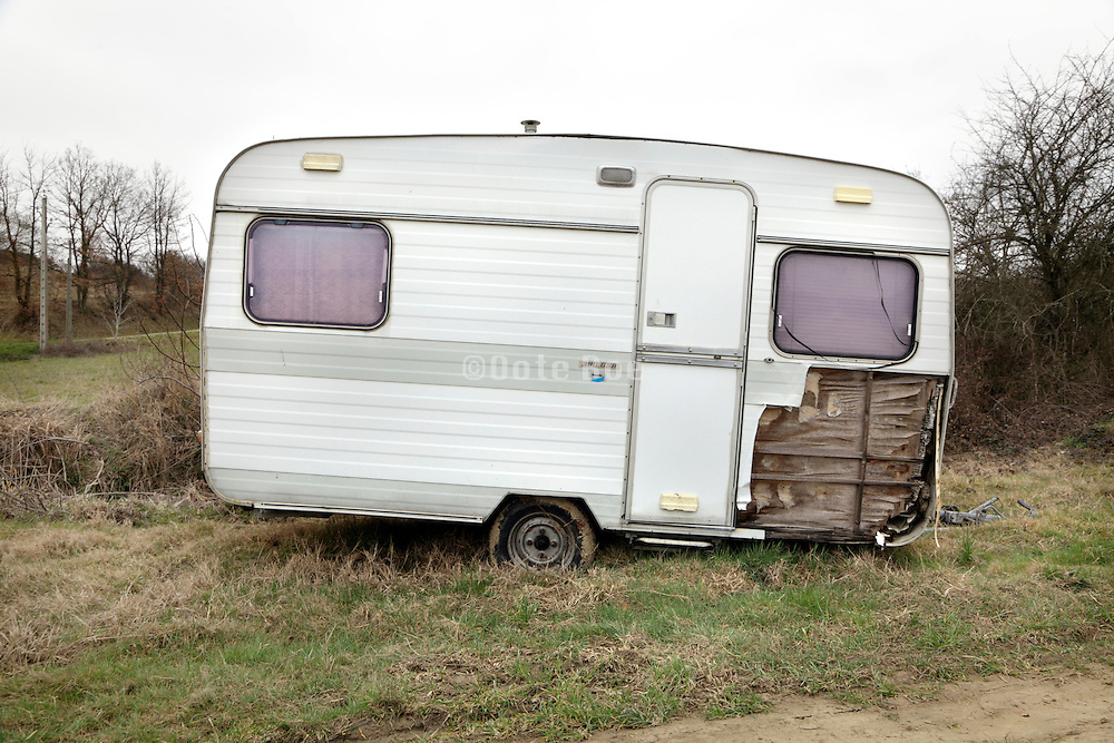 broken old caravan in rural setting