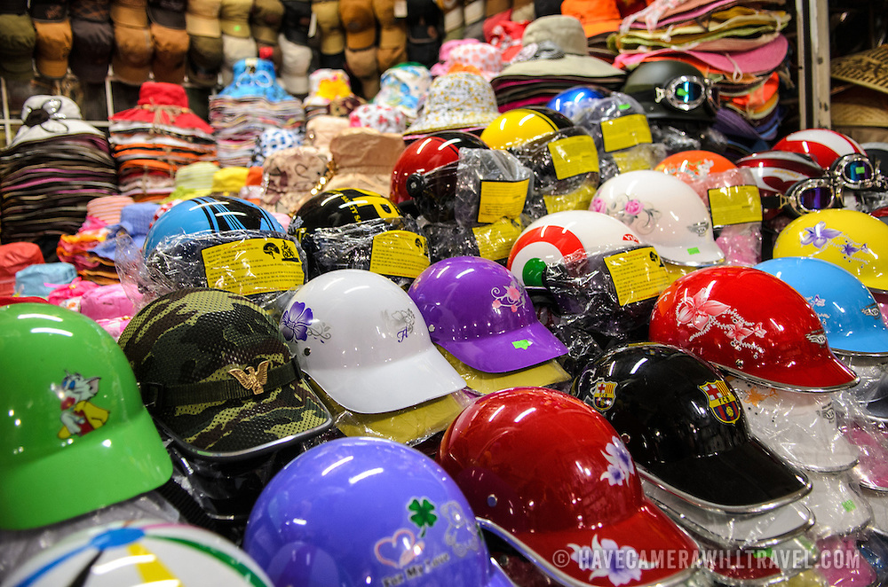 Decorated scooter helmets available for sale at Cho Dong Ba, the main city market in Hue, Vietnam.
