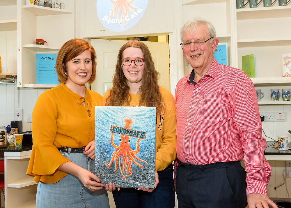 The Kinsale Youth Cafe has a new name, The Quid Cafe. Pictured at the prize giving for a competition to pick a new logo and mural was organiser Sophie Reed-Becks; logo winner Róisín Nyhan and Gerry Wycherly, Squid Cafe Committee.<br /> Picture. John Allen