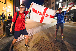 © Licensed to London News Pictures. 7/07/2021. Leeds, UK. English fans celebrate the victory of England in Leeds city centre after the Euro 2020 Semi-Final match between England and Denmark, played at Wembley. Photo credit: Ioannis Alexopoulos/LNP
