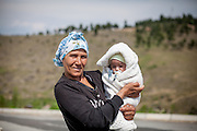 Woman holding a new born child at the Roma part of the city of Vinica in Macedonia.