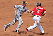 ATLANTA - JUNE 28:  Left fielder Jeff Francoeur #7 of the Atlanta Braves is tagged out by shortstop Nick Green #22 of the Boston Red Sox during a rundown in the game at Turner Field on June 28, 2009 in Atlanta, Georgia.  The Braves beat the Red Sox 2-1.  (Photo by Mike Zarrilli/Getty Images)