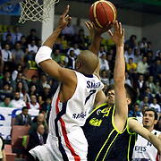 Efes Pilsen's Charles SMITH (L), Kaya PEKER (R) during their Turkish Basketball league Play Off Final first leg match Efes Pilsen between Fenerbahce Ulker at the Ayhan Sahenk Arena in Istanbul Turkey on Thursday 20 May 2010. Photo by Aykut AKICI/TURKPIX
