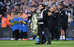 Aiyawatt Srivaddhanaprabha lays a wreath for Armistice Day and those who lost their lives in the Leicester City helicopter crash including Leicester City chairman Vichai Srivaddhanaprabha ahead of the Premier League match at the King Power Stadium, Leicester.
