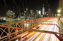 THEMENBILD - Die Brooklyn Bridge ist eine Schraegseil- und Haengebruecke in New York City und ist eine der aeltesten Bruecken dieses Typs in Amerika. Fertiggestellt 1883, verbindet sie Manhattan mit Brooklyn ueber den East River, im Bild die Strasse fuer Autos mit einer Belichtungszeit von 13 Sekunden, Aufgenommen am 28. August 2016 // The Brooklyn Bridge is a hybrid cable-stayed/suspension bridge in New York City and is one of the oldest bridges of either type in the United States. Completed in 1883, it connects the boroughs of Manhattan and Brooklyn by spanning the East River. This picture shows the roadway with an exposure time of 13 seconds, New York City, United States on 2016/08/28. EXPA Pictures © 2016, PhotoCredit: EXPA/ Sebastian Pucher