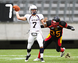 10.07.2011, Tivoli Stadion, Innsbruck, AUT, American Football WM 2011, Group A, Germany (GER) vs United States of America (USA), im Bild Cody Hawkins (USA, #7, QB) gets under pressure from Robert Zernicke (Germany, #35, DL)  // during the American Football World Championship 2011 Group A game, Germany vs USA, at Tivoli Stadion, Innsbruck, 2011-07-10, EXPA Pictures © 2011, PhotoCredit: EXPA/ T. Haumer