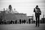 Man reads a sports newspaper near the Lisbon Port<br /> Credit: Rodrigo Cabrita/4SEE