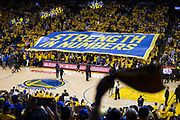 """A """"Strength in Numbers"""" banner flies over the fans during Game 1 of the NBA Finals between Golden State Warriors and Cleveland Cavaliers at Oracle Arena in Oakland, Calif., on June 1, 2017. (Stan Olszewski/Special to S.F. Examiner)"""
