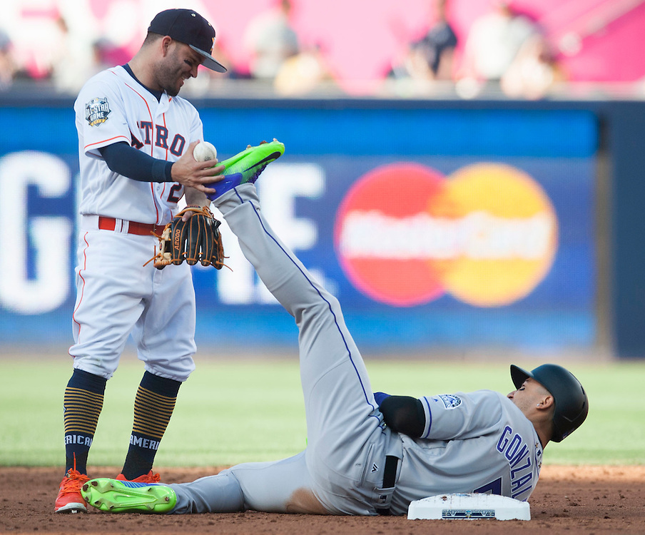 The Astros' Jose Altuve laughs with the Rockies Carlos Gonzalez in the third inning during the 2016 MLB All-Star Game at Petco Park in San Diego on Tuesday.<br /> <br /> ///ADDITIONAL INFO:   <br /> <br /> allstar.0713.kjs  ---  Photo by KEVIN SULLIVAN / Orange County Register  -- 7/12/16<br /> <br /> The 2016 MLB All-Star Game at Petco Park in San Diego.