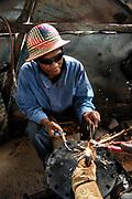 Deaf workers<br /> Metal factory<br /> making metal artefacts for tourist industry<br /> Antananarivo<br /> MADAGASCAR