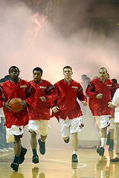 Vince Greene leads the way for the Illinois State Redbird Men's basketball team throught the smoke and lights.