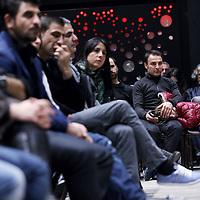 Nederland, Amsterdam , 9 november 2014.<br /> Bijeenkomst van koerden en lezing van de heer Salih Muslim, leider van PYD (Partiya Demokrat) in Rokava Noord Syrie omtrenthuidige toestand in Syrie en met name ivm met de geweldadige opmars van IS (Islamitische Staat) in de regio.<br /> Op de foto: Koerdische bezoekers van de lezing luisteren naar het verhaal van Salih Muslim<br /> Foto:Jean-Pierre Jans