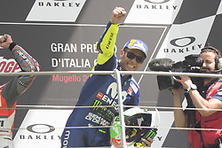 June 3, 2018 - Scarperia, Italy - Movistar Yamaha's Italian rider Valentino Rossi celebrates on the podium after he placed third in the Moto GP Grand Prix at the Mugello race track on June 3, 2018. (Credit Image: © Fabio Averna/NurPhoto via ZUMA Press)