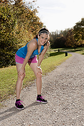 Woman jogging in park, Woerthsee, Bavaria, Germany