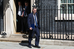 London, UK. 23 July, 2019. David Gauke MP, Lord Chancellor and Secretary of State for Justice, leaves 10 Downing Street following the final Cabinet meeting of Theresa May's Premiership. The name of the new Conservative Party Leader, and so the new Prime Minister, is to be announced at a special event afterwards.