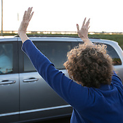 CHARLESTON SC - MARCH 22: A supporter of Democratic presidential candidate, Beto O'Rourke, waves as the ex-congressman departs in a rental mini van at a meet and greet outside of Tradesman Brewing Company in Charleston, SC on March, 22, 2019. (Logan Cyrus for The New York Times)