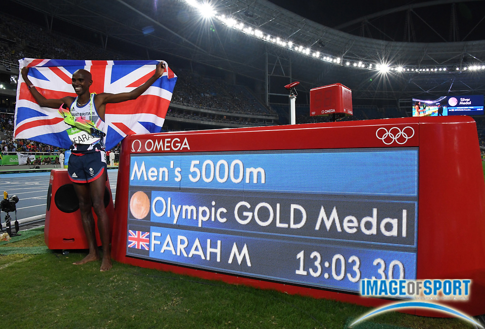 Aug 20, 2016; Rio de Janeiro, Brazil; Mo Farah aka Mohamed Farah (GBR) poses with British flag after winning the 5,000m in 13:03.30 during the 2016 Rio Olympics at Estadio Olimpico Joao Havelange. <br /> <br /> *