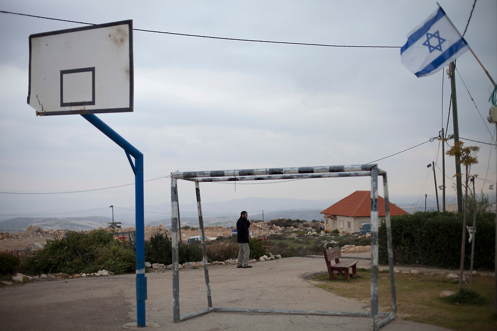 A Jewish settler is seen at the unauthorized West Bank outpost of Migron, on January 17, 2012. Israel's Supreme Court ordered the evacuation of Migron, the largest outpost in the West Bank, built on private Palestinian land, by March 2012.
