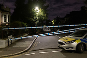 A Met Police car blocks  local roads surrounding Herne Hill and Carnegie Library in Lambeth, after two people were reported shot in a nearby residential south London road, on 10th September 2020, in London, England. The two victims were taken to hospital with non-life threatening injuries.