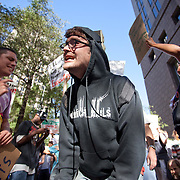 A protestor repeats a slogan at a protest march in front of Bank Of America HQ in uptown Charlotte, NC.