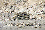 stones stacked in a moon like landscape