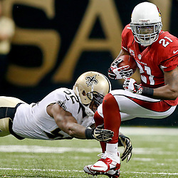 Sep 22, 2013; New Orleans, LA, USA; Arizona Cardinals returner Patrick Peterson (21) is tackled by New Orleans Saints inside linebacker Kevin Reddick (52) on a punt return during the first half of a game at Mercedes-Benz Superdome. The Saints defeated the Cardinals 31-7.Mandatory Credit: Derick E. Hingle-USA TODAY Sports
